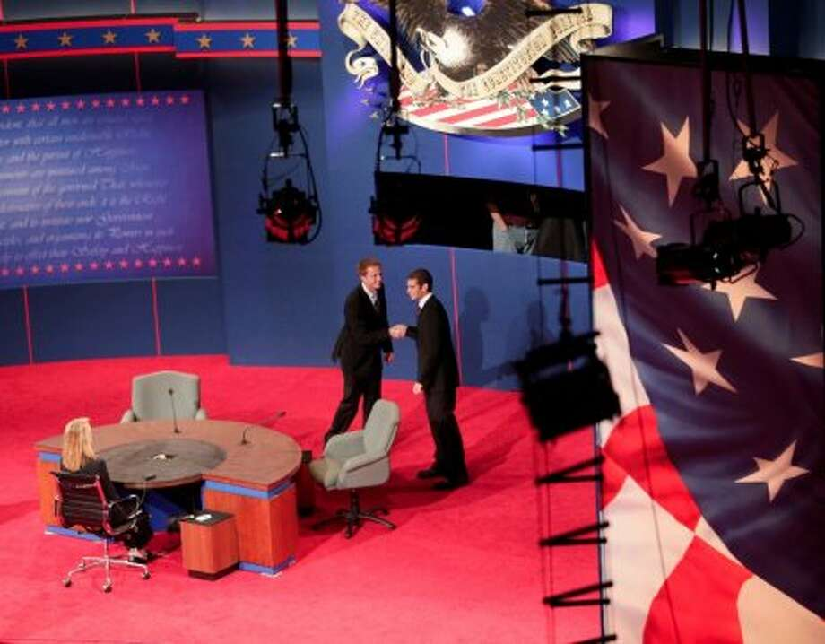 Students posing as Vice President Joe Biden, and Republican vice presidential candidate, Rep. Paul Ryan, R-Wis., shake hands during set up for Thursday's vice presidential debate, Wednesday, Oct. 10, 2012, at Centre College in Danville, Ky. (AP Photo/Morry Gash) (ASSOCIATED PRESS)
