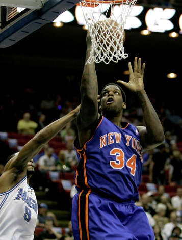 New York Knicks center Eddy Curry (34) goes up past Orlando Magic forward Rashard Lewis (9) for a shot during the first half in Orlando, Fla., Saturday, March 1, 2008. (John Raoux / Associated Press) Photo: John Raoux, AP / AP