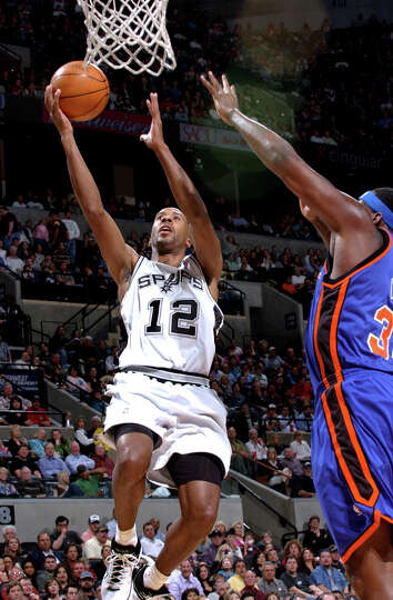 The Spurs' Bruce Bowen goes up for two against the New York Knicks' Eddy Curry on Monday, Feb. 27, 2