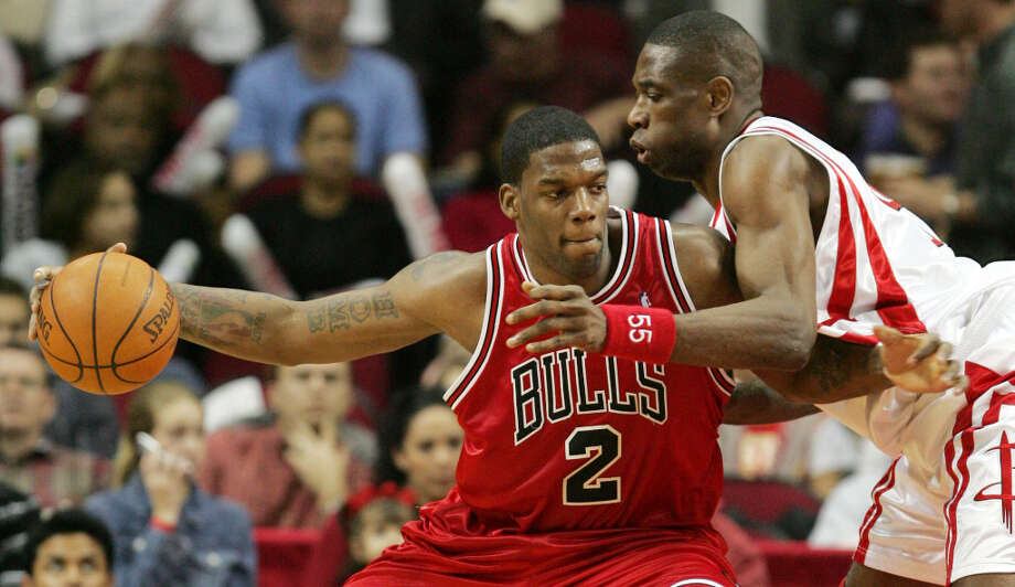 The Chicago Bulls' Eddy Curry (2) works for position against the Houston Rockets' Dikembe Mutombo (right) during the second quarter Wednesday, Feb. 9, 2005 in Houston. (David J. Phillip / Associated Press) Photo: DAVID J. PHILLIP, AP / AP