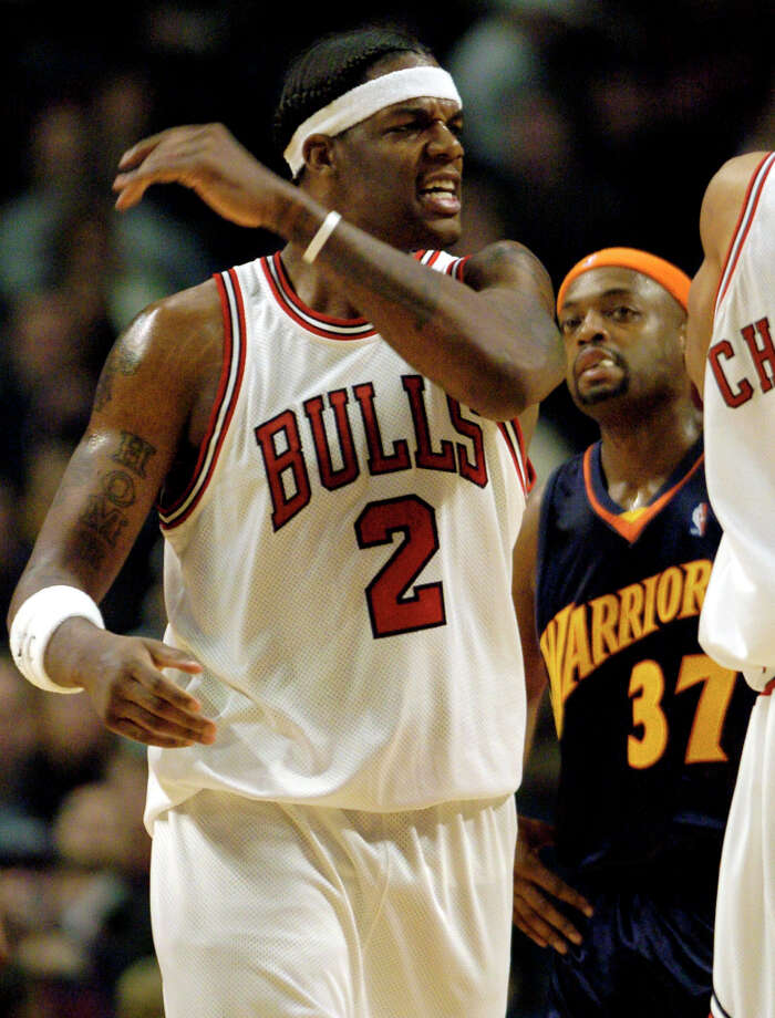 The Chicago Bulls' Eddy Curry (2) reacts after sinking a basket and drawing a foul as the Golden State Warriors' Nick Van Exel (37) looks on during the first quarter Saturday, Feb. 28, 2004 in Chicago. The Bulls won the game 87-81 in overtime. (Jeff Roberson / Associated Press) Photo: JEFF ROBERSON, AP / AP
