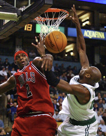 Chicago Bulls center Eddy Curry (left) knock the ball from the hands of Boston Celtics center Vin Baker, right, on a block during the first quarter in Boston, Wednesday, Nov. 12, 2003. (Charles Krupa / Associated Press) Photo: CHARLES KRUPA, AP / AP