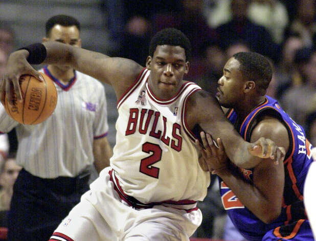 Chicago Bulls rookie Eddy Curry drives to the basket against the New York Knicks' Othella Harrington during the first quarter Saturday, Nov. 03, 2001, in Chicago. (Stephen J. Carrera / Associated Press) Photo: STEPHEN J. CARRERA, AP / AP