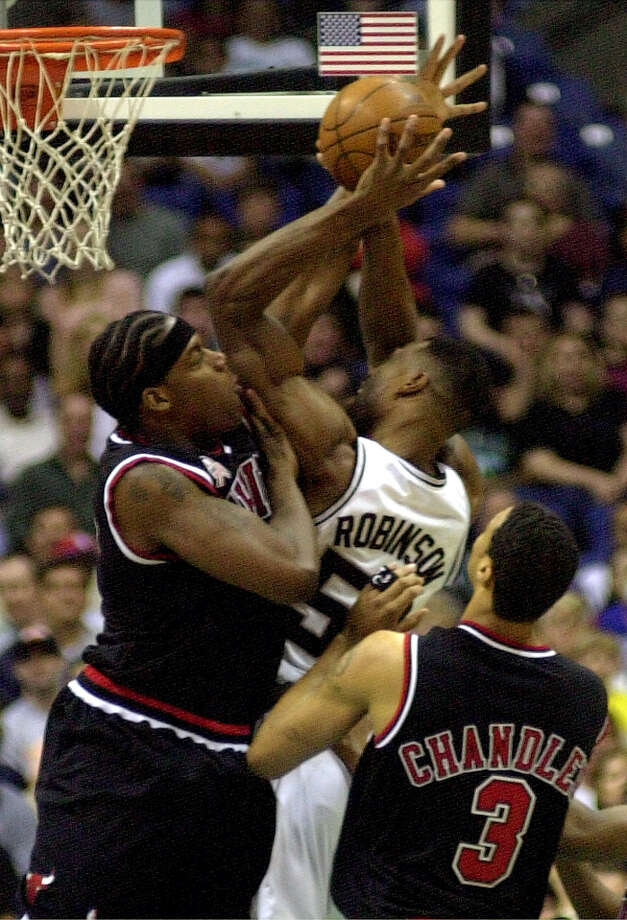 The Chicago Bulls' Eddy Curry (left) defends the Spurs' David Robinson as the Bulls' Tyson Chandler looks on during first period action at the Alamodome Thursday, March 14, 2001. Photo: DOUG SEHRES, SAN ANTONIO EXPRESS-NEWS / SAN ANTONIO EXPRESS-NEWS