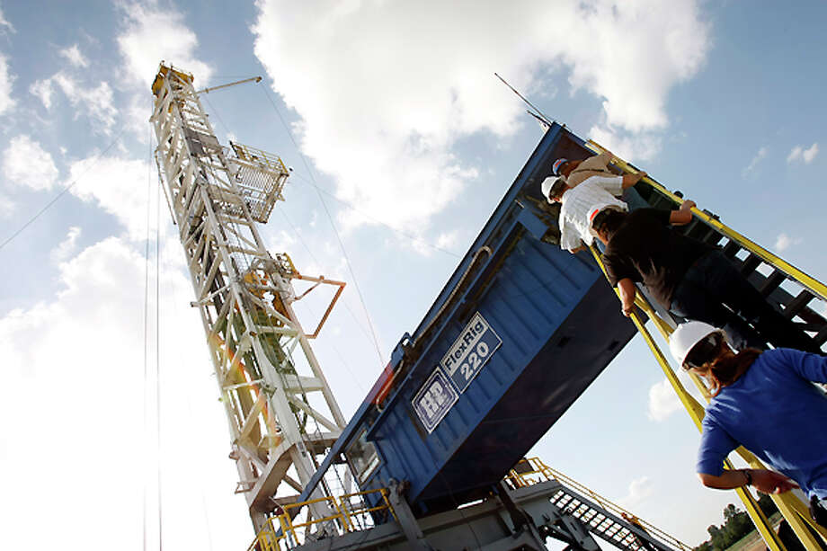 A Devon Energy flex-drilling rig reaches the blue sky Tuesday, June 10, 2008, near Denton. The company's hosts operations in the Barnett Shale, which is the largest natural gas play in Texas; and second on the boom in natural gas shale operations in the U.S. ( Kevin Fujii / Chronicle ) Photo: Kevin Fujii, Houston Chronicle / Houston Chronicle