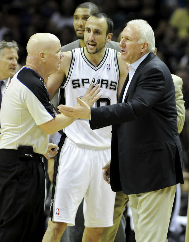 San Antonio Spurs shooting guard Manu Ginobili (20) and San Antonio Spurs head coach Gregg Popovich argue with referee Joe Crawford (left) during a NBA basketball game between the Philadelphia 76ers and the San Antonio Spurs at the AT&T Center in San Antonio, Texas on March 25, 2012.John Albright / Special to the Express-News. Photo: JOHN ALBRIGHT, San Antonio Express-News / San Antonio Express-News