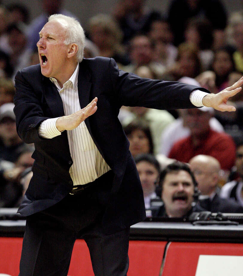 FOR SPORTS - San Antonio Spurs' head coach Gregg Popovich yells instructions to the team against the Memphis Grizzlies during second half action Thursday April 12, 2012 at the AT&T Center. The Spurs won 107-97. Photo: EDWARD A. ORNELAS, SAN ANTONIO EXPRESS-NEWS / © SAN ANTONIO EXPRESS-NEWS (NFS)