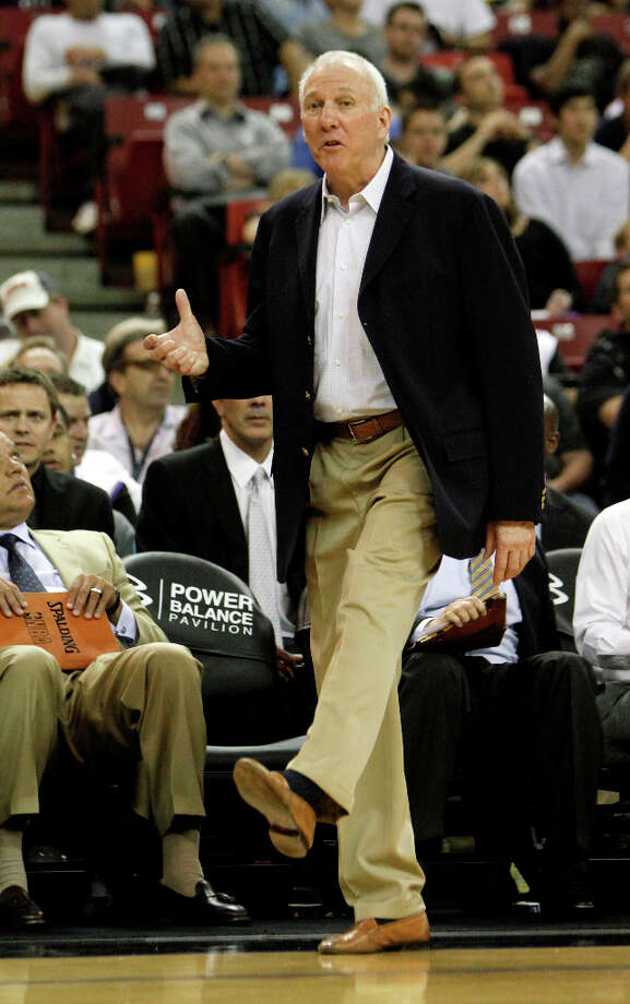 San Antonio Spurs head coach Gregg Popovich, demonstrates to official that the ball had been kicked during play in the second half of an NBA basketball game against the Sacramento Kings in Sacramento, Calif., Wednesday, April 18, 2012. The Spurs won 127-102. Photo: Rich Pedroncelli, AP / AP