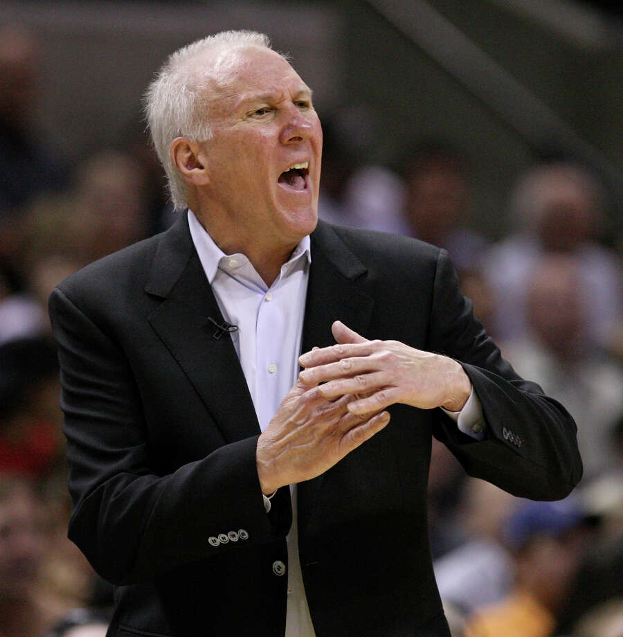 FOR SPORTS - San Antonio Spurs head coach Gregg Popovich calls for a timeout during second half action of Game 1 of the Western Conference first round against the Utah Jazz Sunday April 29, 2012 at the AT&T Center. The Spurs won 106-91. Photo: EDWARD A. ORNELAS, SAN ANTONIO EXPRESS-NEWS / © SAN ANTONIO EXPRESS-NEWS (NFS)