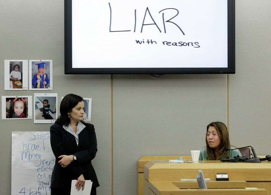 The words shown on a overhead display written by prosecutor Eren Price, left, are shown in court as an emotional Elizabeth Escalona, 23, responds to a line of questioning during the sentencing phase of her trial Thursday, Oct. 11, 2012, in Dallas. Escalona, a young mother of five who admitted beating her toddler and gluing her hands to a wall, faces anywhere from probation to life in prison. (AP Photo/Tony Gutierrez) Photo: Tony Gutierrez, STF / AP