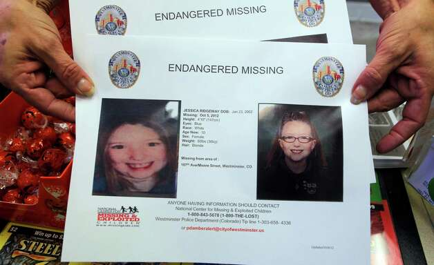A missing poster for ten-year-old Jessica Ridgeway is seen in Broomfield, Colo., on Monday, Oct. 8, 2012. The youngster has been missing since she left her home Friday morning on her way to school. (AP Photo/Ed Andrieski) Photo: Ed Andrieski, STF / AP