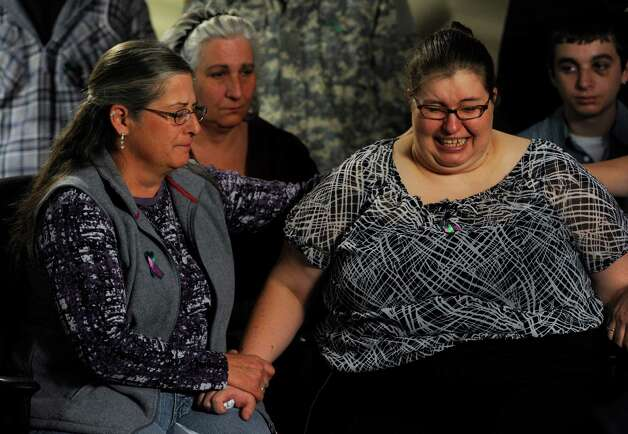 As Jessica's mother, Sarah Ridgeway begins to cry, she is comforted by her  aunt, Gay Moore, left, and by Sarah's great aunt Wendy Pesavento at the Westminster Police Department in Westminster, Colo., on Tuesday, Oct. 9, 2012. The family of Jessica Ridgeway gathered to talk about Jessica and ask for her safe return. Jessica went missing Friday while on her way to school. (AP Photo/The Denver Post, Kathryn Scott Osler, Pool) Photo: Kathryn Scott Osler, POOL / POOL The Denver Post