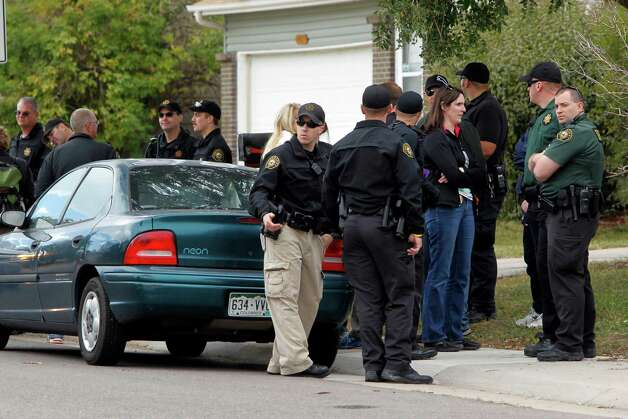 Police gather after canvassing a neighborhood looking for clues in the search for ten-year-old Jessica Ridgeway near her home in Westminster, Colo., on Wednesday, Oct. 10, 2012. The youngster has been missing since she left her home Friday morning on her way to school. (AP Photo/Ed Andrieski) Photo: Ed Andrieski, STF / AP