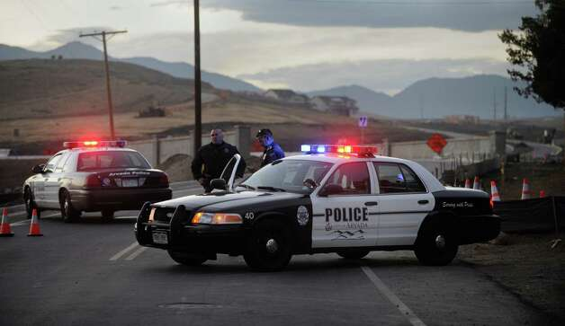 Arvada police officers manned a roadblock Wednesday evening, Oct. 10, 2012. A body was found near an open space area in the Denver suburb of Arvada Wednesday Oct. 10, 2012.  Westminster police spokesman Trevor Materasso said Wednesday that so far, police haven't connected it to the disappearance of 10-year-old Jessica Ridgeway, whose mother last saw her leaving for school Friday. Her father lives in Independence, Mo.  (AP Photo/Karl Gehring, The Denver Post Photo: Karl Gehring, MBR / THE DENVER POST