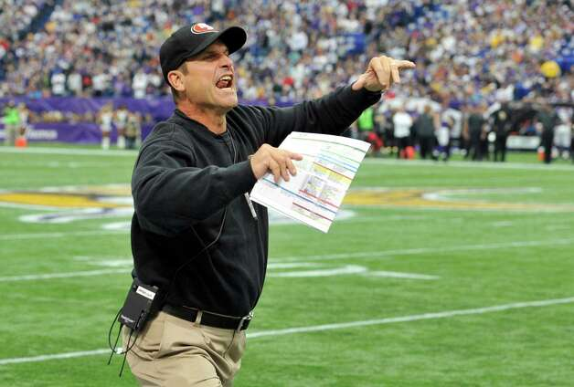 San Francisco 49ers head coach Jim Harbaugh reacts to a penalty called against his team during the first half of an NFL football game against the Minnesota Vikings Sunday, Sept. 23, 2012, in Minneapolis. Photo: Jim Mone, Associated Press / AP