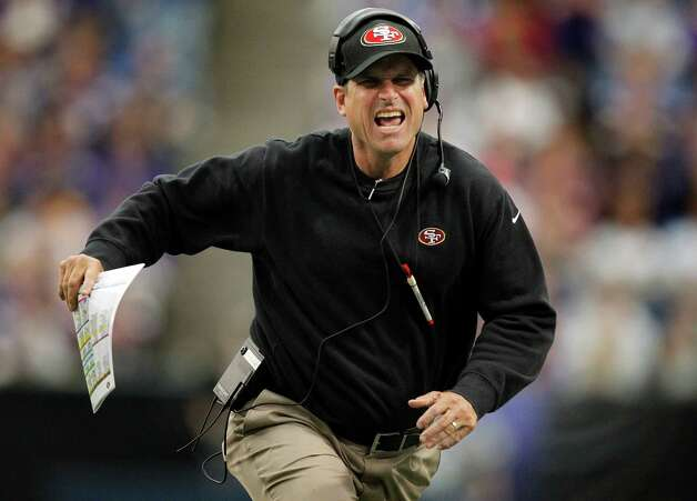 49ers head coach Jim Harbaugh yells at a referee questioning the spot of the ball in the fourth quarter at Mall of America Field in Minneapolis, Minnesota, on Sunday, September 23, 2012. Photo: Carlos Gonzalez, McClatchy-Tribune News Service / Minneapolis Star Tribune