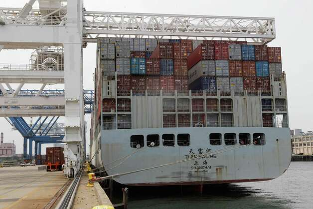 In this Friday, July 13, 2012, photo, a container ship from China is docked at Massport's Conley Terminal in the port of Boston. The U.S. trade deficit widened in August 2012 as exports fell to the lowest level in six months, a worrisome sign that a slowing global economy is cutting into demand for U.S. goods (AP Photo/Stephan Savoia) Photo: Stephan Savoia