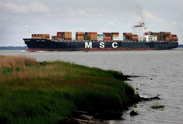 In this Saturday, Aug. 11, 2012, photo, the container ship MSC Emma heads up the Delaware River towards the Port of Philadelphia. The U.S. trade deficit widened in August 2012 as exports fell to the lowest level in six months, a worrisome sign that a slowing global economy is cutting into demand for U.S. good (AP Photo/Mark Lennihan) Photo: Mark Lennihan