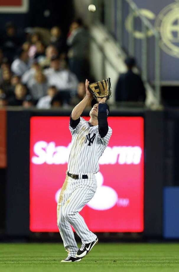 NEW YORK, NY - OCTOBER 11: Jayson Nix #17 of the New York Yankees catches a ball hit by Ryan Flaherty of the Baltimore Orioles  during Game Four of the American League Division Series at Yankee Stadium on October 11, 2012 in the Bronx borough of New York City. Photo: Elsa, Getty Images / 2012 Getty Images