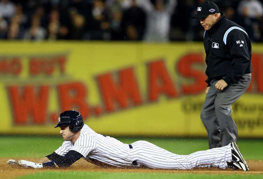 NEW YORK, NY - OCTOBER 11: Jayson Nix #17 of the New York Yankees slides into second base after hitting a double  during Game Four of the American League Division Series against the Baltimore Orioles at Yankee Stadium on October 11, 2012 in the Bronx borough of New York City. Photo: Al Bello, Getty Images / 2012 Getty Images