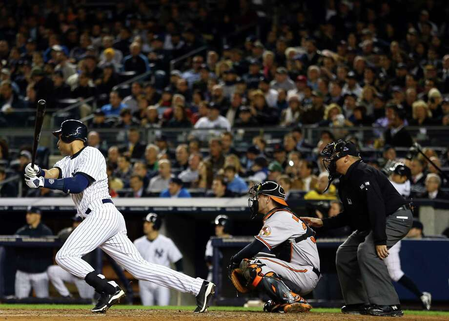 NEW YORK, NY - OCTOBER 11: Derek Jeter #2 of the New York Yankees hits a double in the sixth inning of Game Four of the American League Division Series against the Baltimore Orioles at Yankee Stadium on October 11, 2012 in the Bronx borough of New York City. Photo: Al Bello, Getty Images / 2012 Getty Images