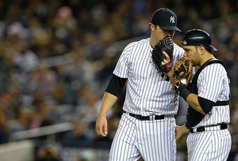 NEW YORK, NY - OCTOBER 11: Phil Hughes #65 of the New York Yankees speaks with Russell Martin #55  during Game Four of the American League Division Series against the Baltimore Orioles at Yankee Stadium on October 11, 2012 in the Bronx borough of New York City. Photo: Al Bello, Getty Images / 2012 Getty Images