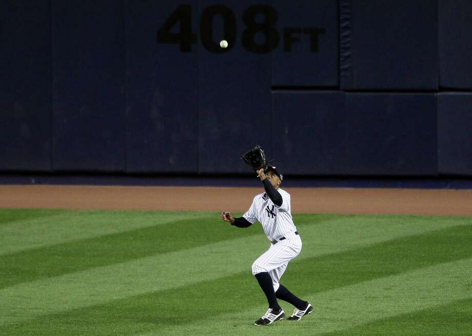 NEW YORK, NY - OCTOBER 11:  Curtis Granderson #14 of the New York Yankees makes a catch during Game Four of the American League Division Series against the Baltimore Orioles at Yankee Stadium on October 11, 2012 in the Bronx borough of New York City. Photo: Alex Trautwig, Getty Images / 2012 Getty Images