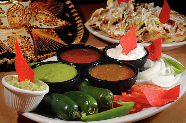 Salsas and dips at Taqueria Cotija in Nederland. 3720 Avenue E Nederland, Texas. Photo taken Wednesday, October 3, 2012 Guiseppe Barranco/The Enterprise Photo: Guiseppe Barranco, STAFF PHOTOGRAPHER / The Beaumont Enterprise