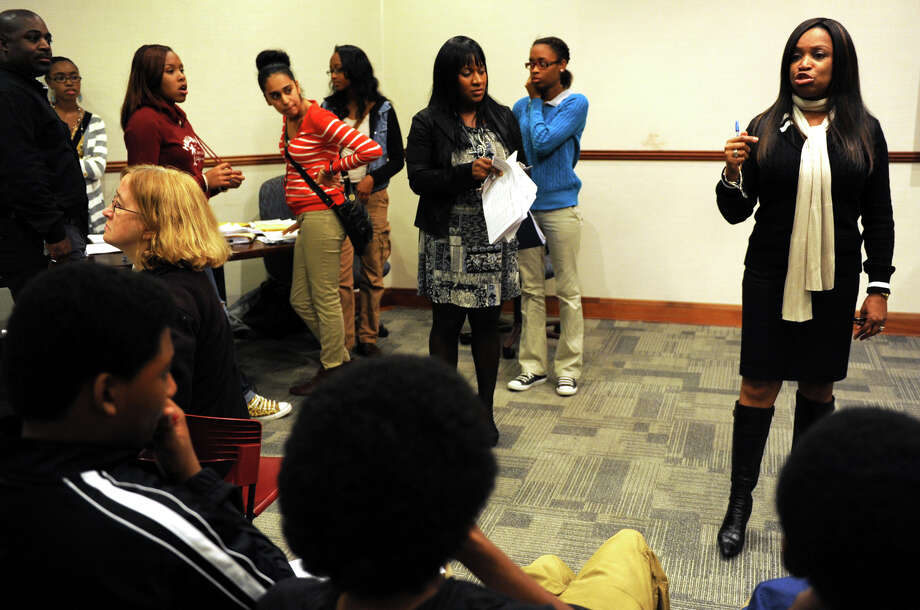 Teresa Wilson, Director of V.I.P (The Village Initiative Project), speaks to students and parents about an upcoming tour of colleges during a planning meeting at the Morton Government Center, in Bridgeport, Conn. Oct. 10th, 2012. Photo: Ned Gerard / Connecticut Post