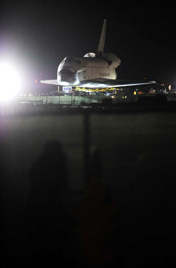 Space Shuttle Endeavour begins its final journey at Los Angeles International Airport (LAX) to its permanent home, in the early morning hours October 12, 2012 in Los Angeles, California.   Over the next two days, the 170,000-pound (77,272 kg) shuttle will travel at no more than 2 mph (3.2 km per hour) along a 12-mile (19km) route from LAX to it's final home at the California Science Center. NASA Space Shuttle Program ended in 2011 after 30 years and 135 missions. AFP PHOTO / Robyn BeckROBYN BECK/AFP/GettyImages Photo: ROBYN BECK, AFP/Getty Images / AFP