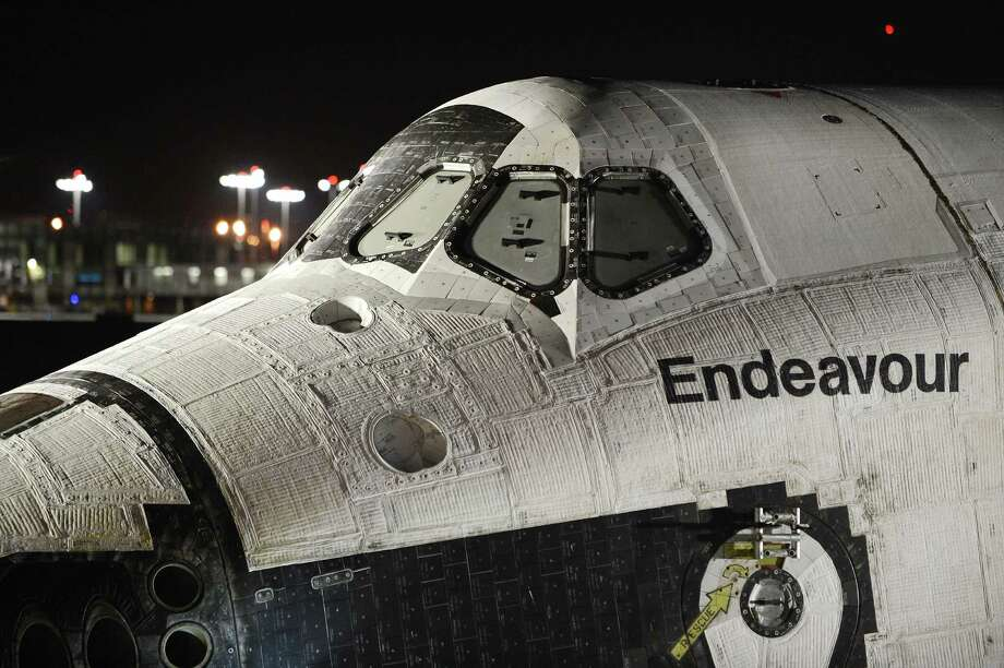 TOPSHOTS A view of the front panels of Space Shuttle Endeavour as Endeavour begins its journey to its permenant home in Los Angeles, in the early morning hours Oct 12, 2012 at Los Angeles International Airport (LAX) in Los Angeles, California. Over the next two days, the 170,000-pound (77,272 kg) shuttle will travel at no more than 2 mph (3.2 km per hour) along a 12-mile (19km) route from LAX to it's final home at the California Science Center. NASA Space Shuttle Program ended in 2011 after 30 years and 135 missions. AFP PHOTO / Robyn BeckROBYN BECK/AFP/GettyImages Photo: ROBYN BECK, AFP/Getty Images / AFP