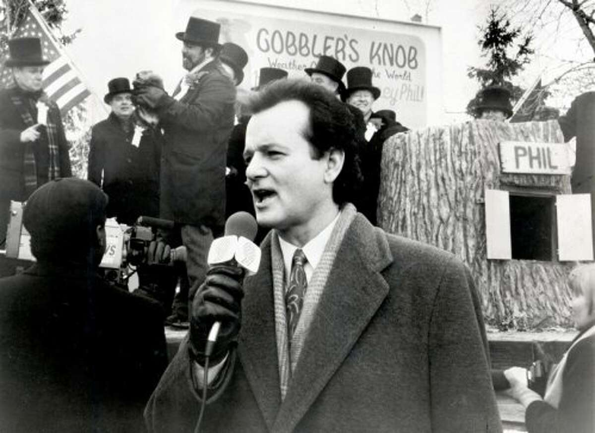 """Bill Murray reporting from Punxsutawney, Pennsylvania in """"Groundhog Day,"""" for the first, second, or maybe 500th time. (SFC)"""