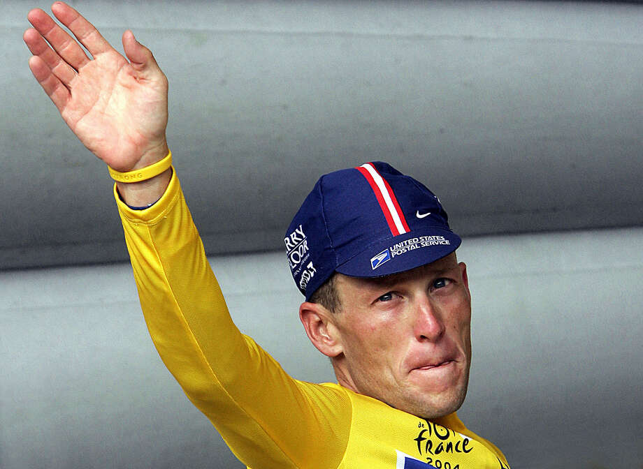 (FILES): This 24 July 2004 file photo shws Lance Armstrong of the US waving to the crowd after he retained the yellow jersey as overall leader at the end of the 19th stage of the 91st Tour de France cycling race, a time trial in Besancon. Lance Armstrong on October 11, 2012 gave off an air of indifference to claims that he was at the centre of the biggest doping scandal in sporting history. Eleven former team-mates gave evidence against Armstrong -- who battled back from life-threatening cancer to win the Tour de France seven times -- accusing him of taking banned substances and enforcing a doping culture within the team.    AFP PHOTO/FILES/PATRICK KOVARIKPATRICK KOVARIK/AFP/GettyImages Photo: PATRICK KOVARIK, AFP/Getty Images / 2005 AFP