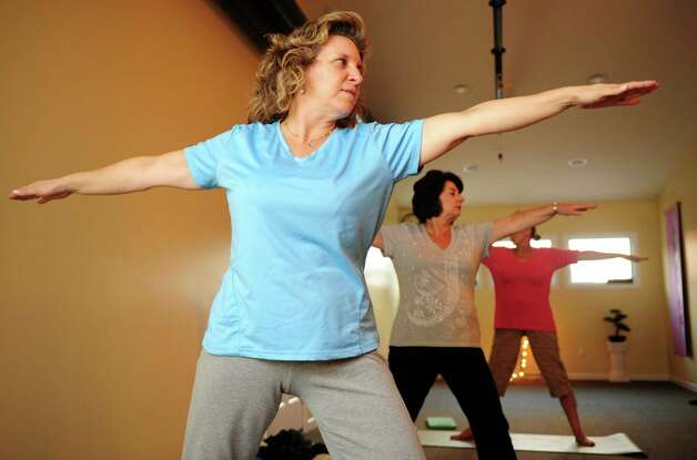 Charice Aube takes a Gentle Hatha Yoga class Wednesday, Oct. 10, 2012 at Mother's Embrace Yoga Studio in Shelton. Photo: Autumn Driscoll / Connecticut Post