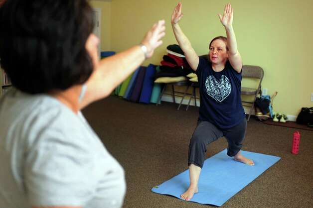 Jill Driscoll, of Stratford, takes a Gentle Hatha Yoga class Wednesday, Oct. 10, 2012 at Mother's Embrace Yoga Studio in Shelton. Photo: Autumn Driscoll / Connecticut Post