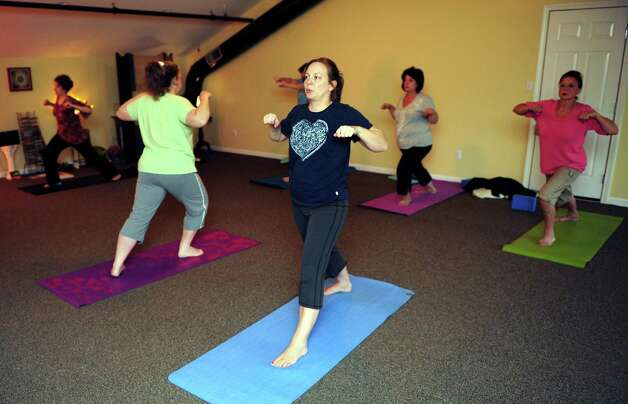 Linda Antignani leads a Gentle Hatha Yoga class Wednesday, Oct. 10, 2012 at Mother's Embrace Yoga Studio in Shelton. Photo: Autumn Driscoll / Connecticut Post