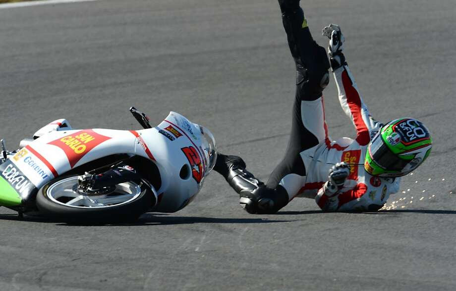 That's going to leave a mark: Niccolo Antonelli of Italy takes a high-speed spill at the V-turn during practice for the MotoGP Japanese Grand Prix in Motegi. Photo: Toshifumi Kitamura, AFP/Getty Images