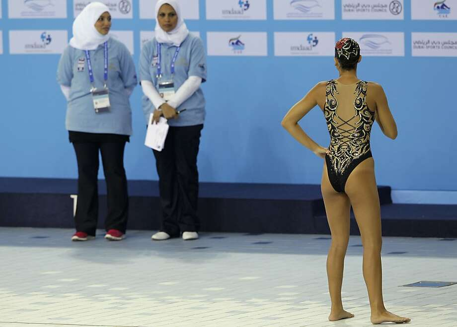 Cultures clashas the Synchronized Swimming Championships come to Dubai, in a country - the United Arab Emirates - where it's customary for women to cover up completely. Photo: Kamran Jebreili, Associated Press