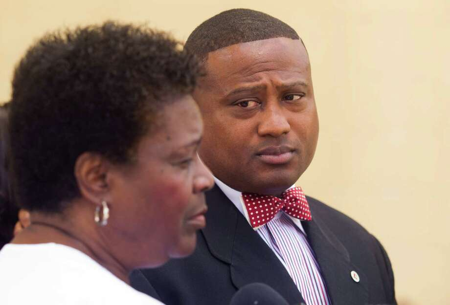Quanell X stands with Anna Patterson during a press conference Thursday.( J. Patric Schneider / For the Chronicle ) Photo: J. Patric Schneider / © 2012 Houston Chronicle