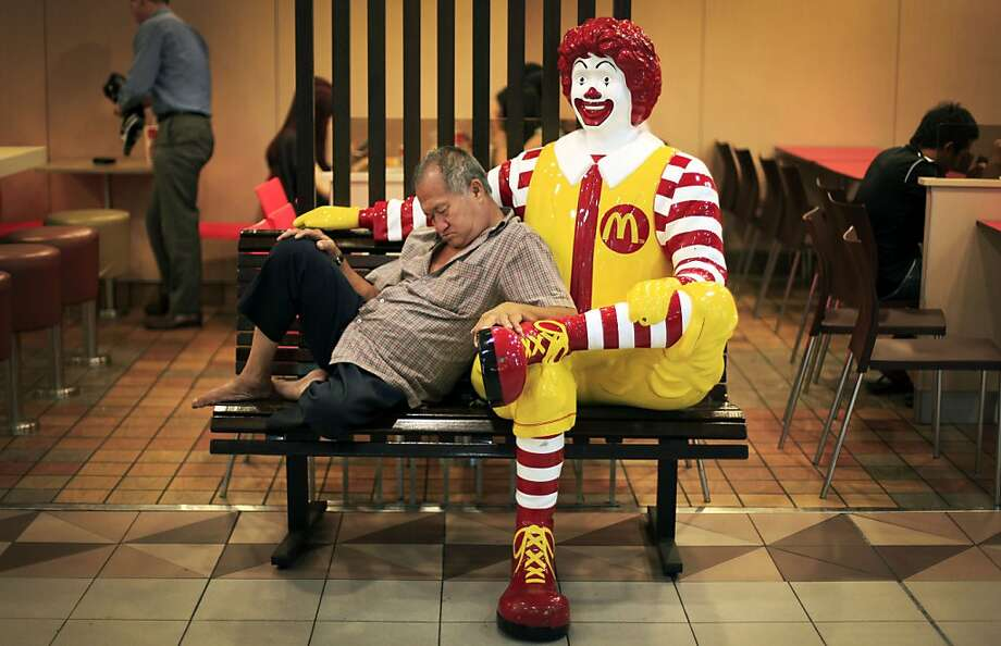 You deserve a nap break today: Eight Big Macs, six large fries and a couple of shakes later ... (Singapore.) Photo: Wong Maye-E, Associated Press