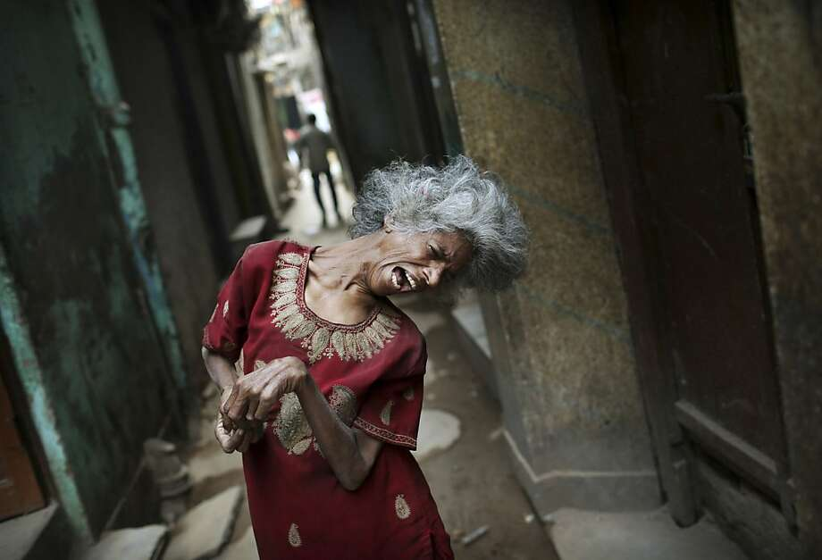 India's helpless: A severely disabled woman begs for change in an alleyway in New Delhi. Photo: Kevin Frayer, Associated Press