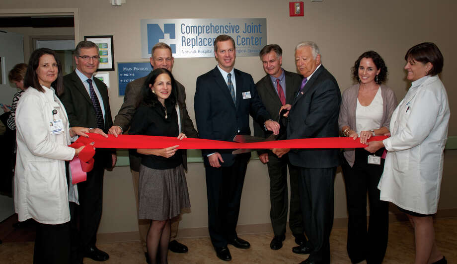 The Comprehensive Joint Replacement Center at Norwalk Hospital had its official grand opening for the general public on Thursday evening in its newly dedicated unit on 7 East in the main pavilion of the hospital. Fromleft are: Alison Vail, RN, patient care manager; Nicholas V. Polifroni, M.D., and Michael Lynch, MD, the medical directors for the Comprehensive Joint Replacement Center, who are both in practice with Coastal Orthopaedics; state Rep. Gail Lavielle, Dan DeBarba, president and CEO, Norwalk Hospital, Klaus Thaler, MD, chairman, Department of Surgery, Norwalk Mayor Richard Moccia, Courtney Lyddy, joint care coordinator, and Beverly Lyon, RN, director of patient care services. Photo: Contributed Photo