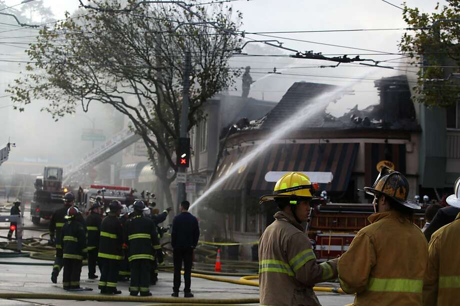 Firefighters still fighting a fire which started around 5:00am at the Squat and Gobble restaurant in West Portal in San Francisco, Calif., on Friday, October 12, 2012. Photo: Liz Hafalia, The Chronicle