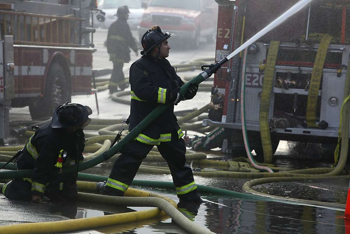 Firefighters still fighting a fire which started around 5:00am at the Squat and Gobble restaurant in West Portal in San Francisco, Calif., on Friday, October 12, 2012.