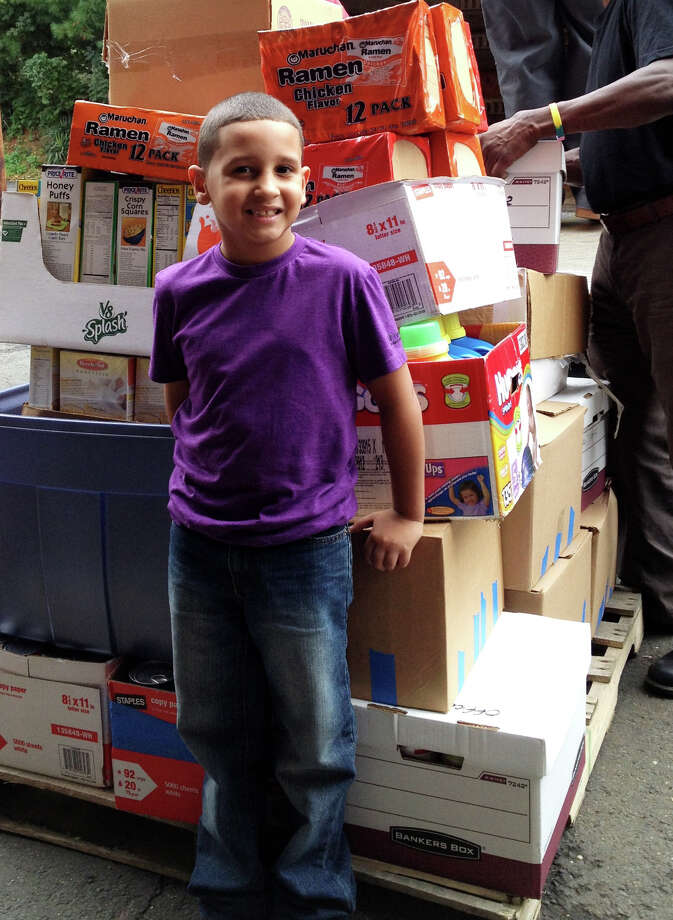 7-year-old Jeremy Rosa of Bridgeport held a food drive that collected 1,053 items, weighing a whopping 997 pounds âÄî the equivalent of 830 meals. The collected food was donated to the Connecticut Food Bank Warehouse in Fairfield, Conn. Photo: Contributed Photo / Connecticut Post Contributed