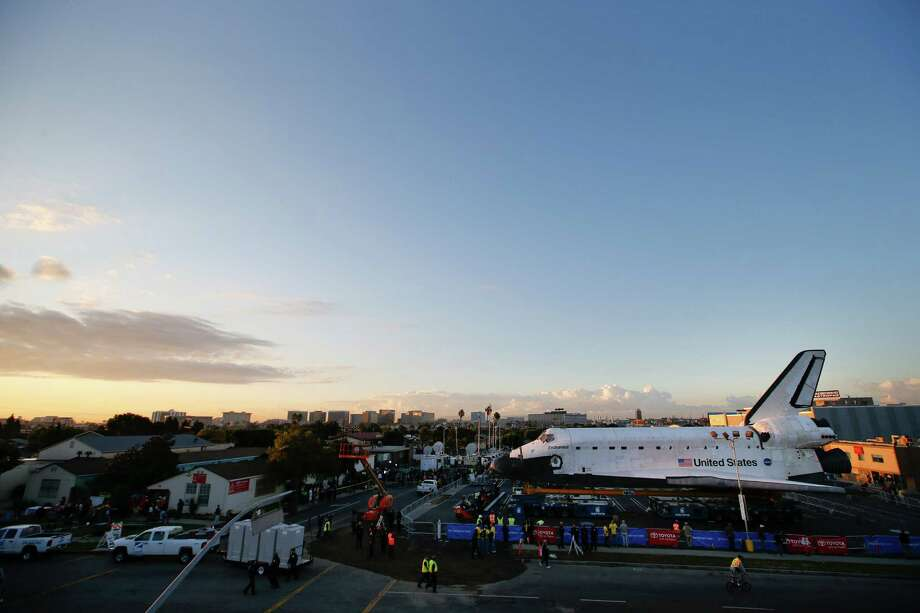The space shuttle Endeavour sits in a strip mall near Los Angeles International Airport in Los Angeles, Friday, Oct. 12, 2012. Endeavour's 12-mile road trip kicked off shortly before midnight Thursday as it moved from its Los Angeles International Airport hangar en route to the California Science Center, its ultimate destination, said Benjamin Scheier of the center. (AP Photo/Jae C. Hong) Photo: Jae C. Hong, Associated Press / AP