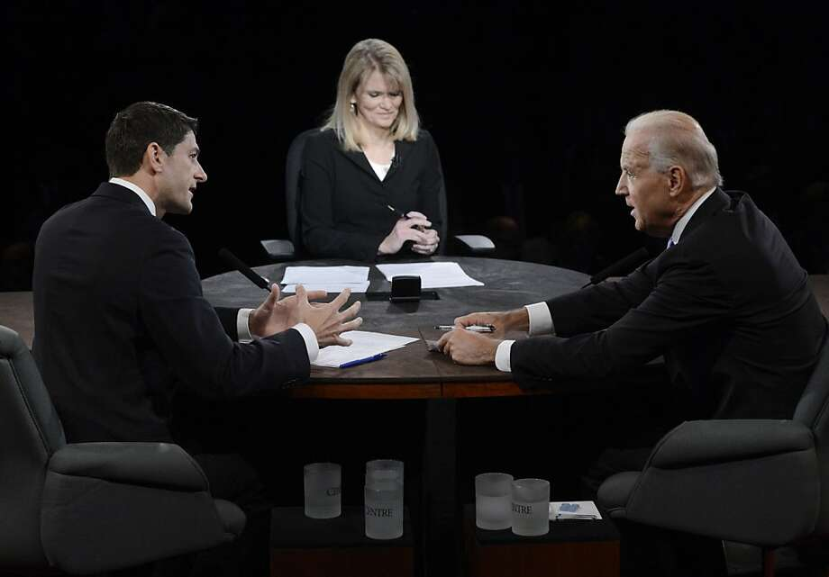Paul Ryan (left) and Joe Biden square off as Martha Raddatz moderates their vice presidential debate at Centre College in Danville, Ky., Thursday. Photo: Michael Reynolds, Associated Press
