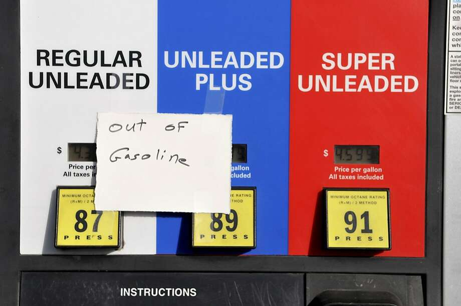 "A note on a gas pump at Porgieís Liquor & Deli in Hesperia, Calif. indicates they are out of regular and unleaded plus gasoline, Friday, Oct. 5, 2012, after the owners shut off their pumps earlier this week while keeping the convenience store open. ""It's like buying gas at $9 a gallon and selling it for $5. We're a mom and pop gasoline station, if we can't make any money, it's pointless,"" said an employee of the store who wished to remain anonymous. Photo: David Pardo, Associated Press"