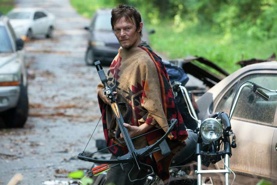 """This undated publicity photo provided by AMC shows Norman Reedus as Daryl Dixon in a scene from AMC's TV show, """"The Walking Dead,"""" Season 3, Episode 5. The show airs Sundays at 9 p.m. EST on AMC. (AP Photo/AMC, Russell Kaye) Photo: Russell Kaye"""