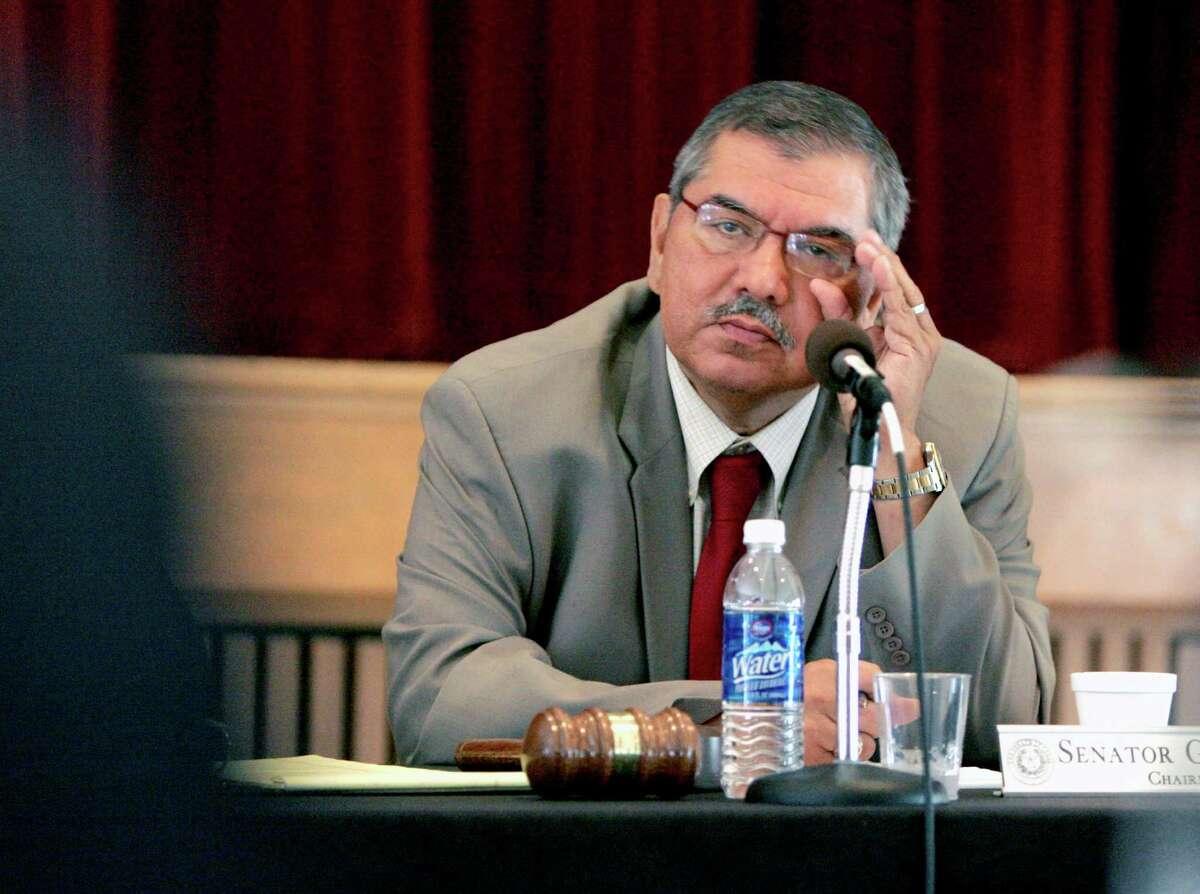 State Sen. Mario Gallegos listens to testimony during a 2009 legislative hearing.